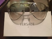 Stainless steel frame. New Versace sunglasses with box slightly Tinted