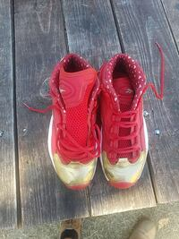 pair of red-and-black Nike running shoes Lakewood, 98499