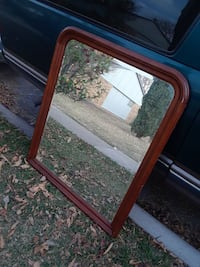 square red wooden framed mirror