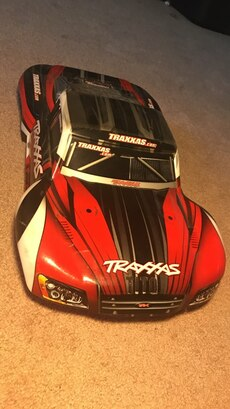 red and black  Traxxas diecast car model