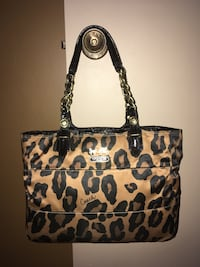 Coach sateen fabric in a bronzed brown &  black Ocelot pattern/black leather trim & gold signature hardware...zip top closure & slit pockets Oakville, L6K 1Y8