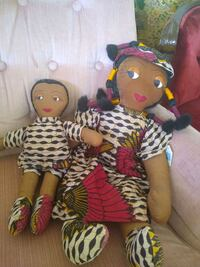 two red and black dressed dolls Glendale, 85302