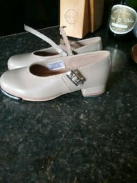 pair of gray Mary Jane leather shoes