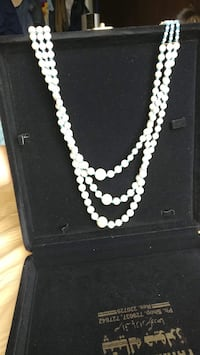 white pearl beaded necklace and earrings
