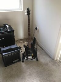 Black electric guitar with black Crate guitar amplifier