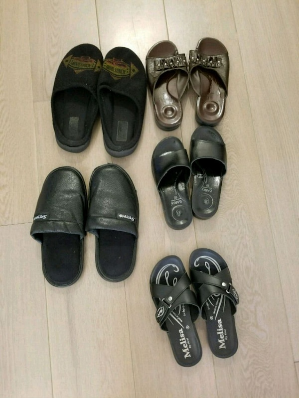 four pairs of black leather shoes