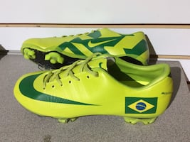 Pair of green-and-yellow Nike cleats