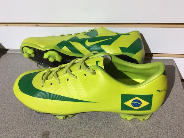 Pair of green-and-yellow Nike cleats 6be8e9bc-9ec8-4a66-80e8-b16bb42080c4