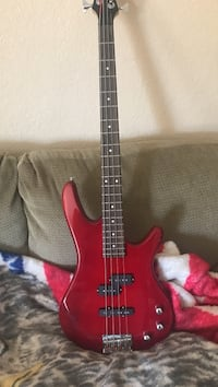 Red and black electric bass guitar Pueblo, 81003
