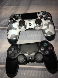 black and gray Sony PS4 controllers Houston, 77081