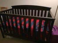 baby's brown wooden crib Farmington, 48335