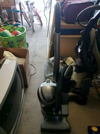 black and gray upright vacuum cleaner