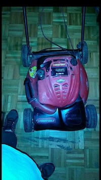 red and black Troy-Bilt push mower
