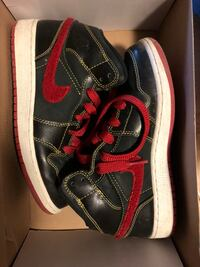 pair of black-and-red Nike sneakers New York