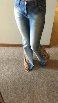 Pair of brown suede  and blue jeans