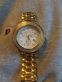round gold Chronograph watch with gold link strap