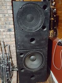 two black PA speakers