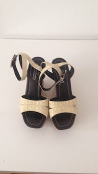 Pair of black-and-white sandals Size 11