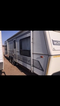 White and gray rv trailer Casa Grande