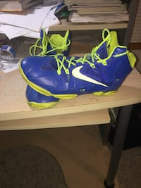 pair of blue-and-yellow Nike basketball shoes
