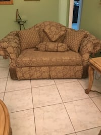 brown and beige floral fabric sofa chair null