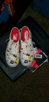 pair of white-and-red Vans sneakers 732 mi