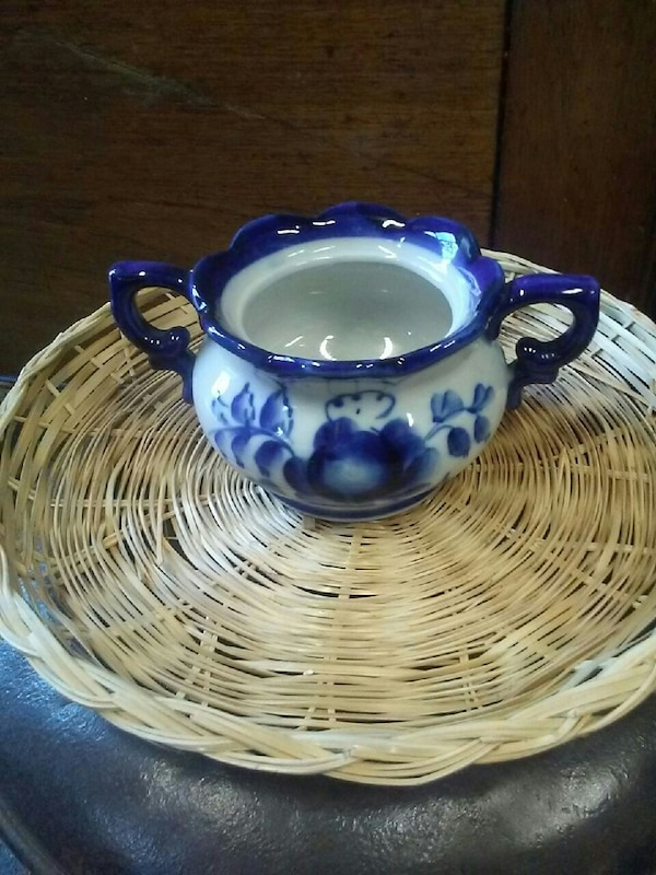 white and blue floral ceramic pot