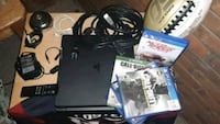 black Xbox 360 with controller and game cases Lakewood, 80214