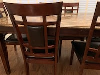 Heavy duty wooden dining table and 6 chairs (6 months old) Brampton, L6X 4P5