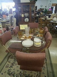 Glass top table with 6 padded chairs Stephens City