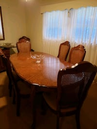 Dining room table with 10 chairs and 2 leafs. Gastonia, 28056