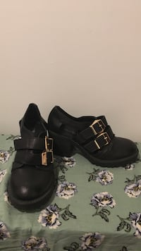 Pair of black belt-strap leather shoes