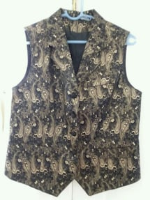Beautiful black and gold vest type top. Size 6/8