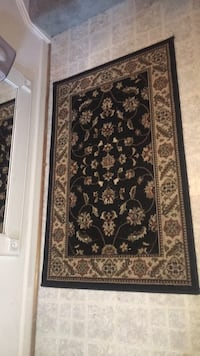 31 in W x 48 in L Brown and black floral area rug Alexandria, 22315