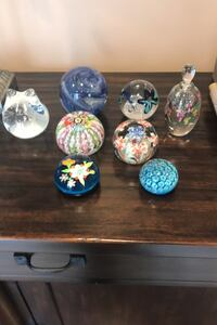 Glass paperweights and perfume bottle