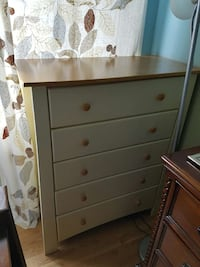 white and brown 5-drawer chest; brown and gray floral window curtain