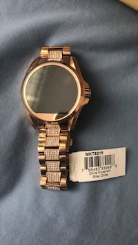 round gold-colored analog watch with link bracelet Toronto, M3C 3A4