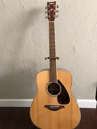 Brown and black dreadnought acoustic guitar York