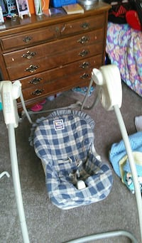 baby's blue and white plaid portable swing