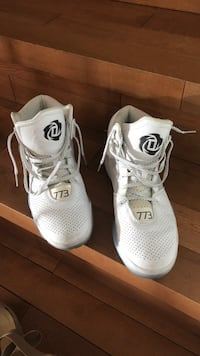 Pair of white adidas D rose shoes