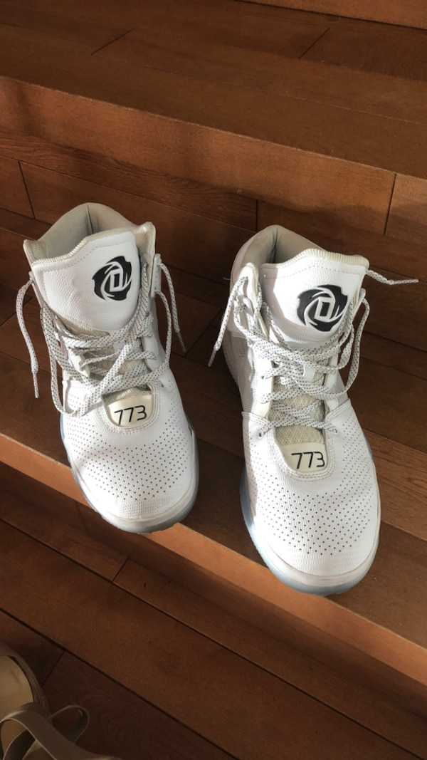 Pair of white adidas D rose shoes a1f5f5f4-cb8c-490b-89cd-4e72d4fa58cc