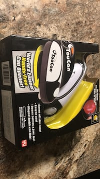 black and yellow and black corded power tool