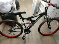 black and red full-suspension bike