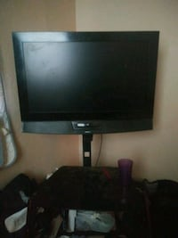 black flat screen TV with remote control