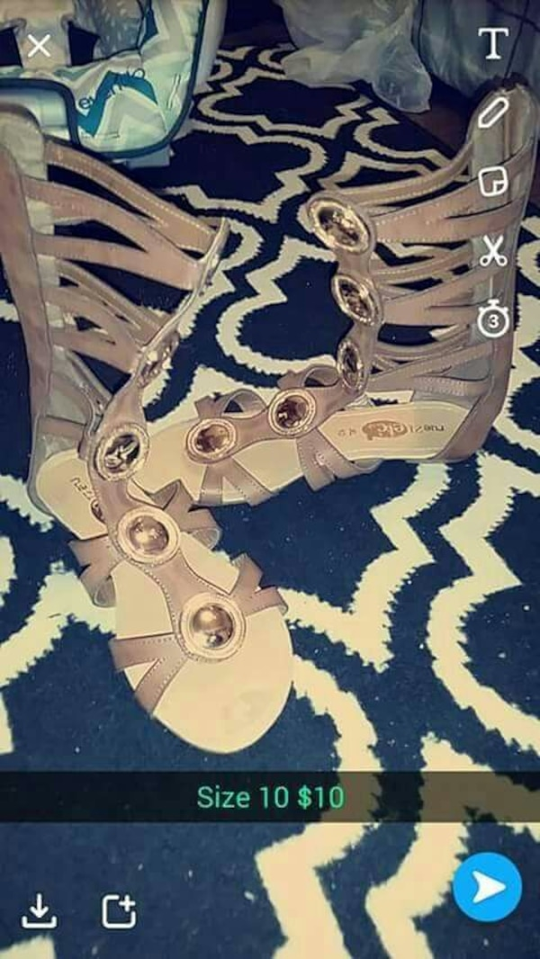 7c1bb0db8b7a Used women s pair of tan-and-white gladiator sandals for sale in Sarcoxie -  letgo