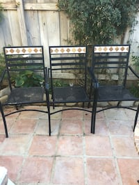 three black-and-white metal armchairs