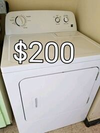 white Kenmore front-load washer with text overlay Toronto, M1T