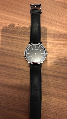 Round black and silver Burberry analog watch with black leather strap