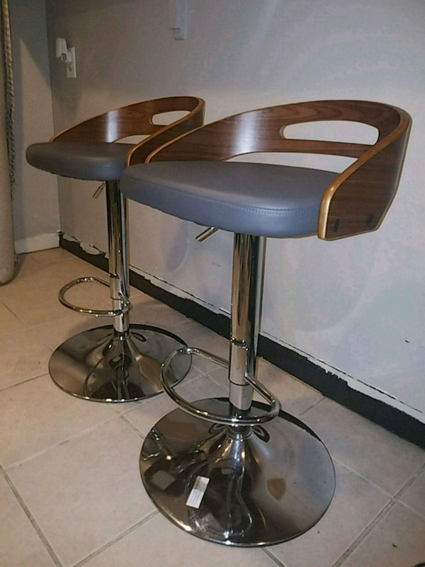 Wooden and gray leather swivel stools