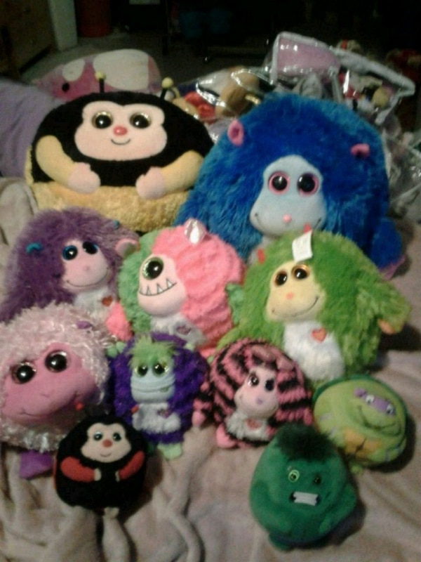assorted color animal plush toys